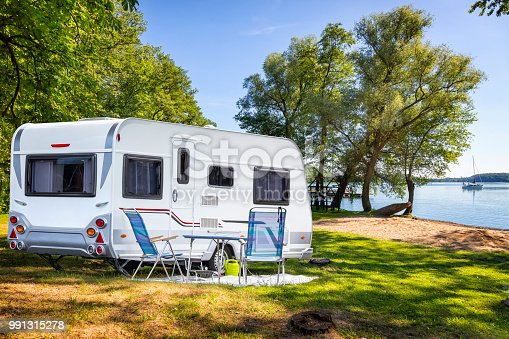 Vacations in Poland - Camper trailer on the shore of bay of the Drawsko lake