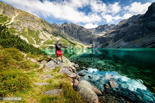 1130859000 istock photo Vacations in Poland - Middle-aged tourist on a trip to the Tatra Mountains 1026529558
