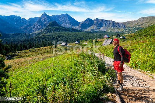 1130859000 istock photo Vacations in Poland - Middle-aged tourist on a trip to the Tatra Mountains 1088687876