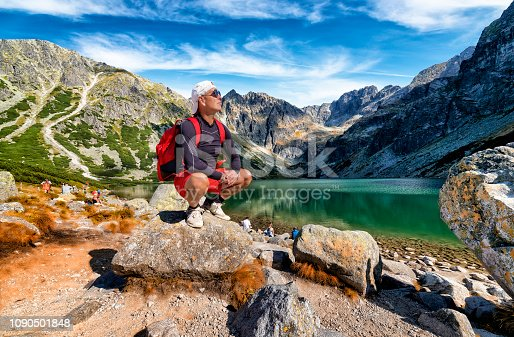 1130859000 istock photo Vacations in Poland - Middle-aged tourist on a trip to the Tatra Mountains 1090501848