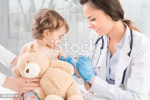 istock Vaccination little girl. 667895140
