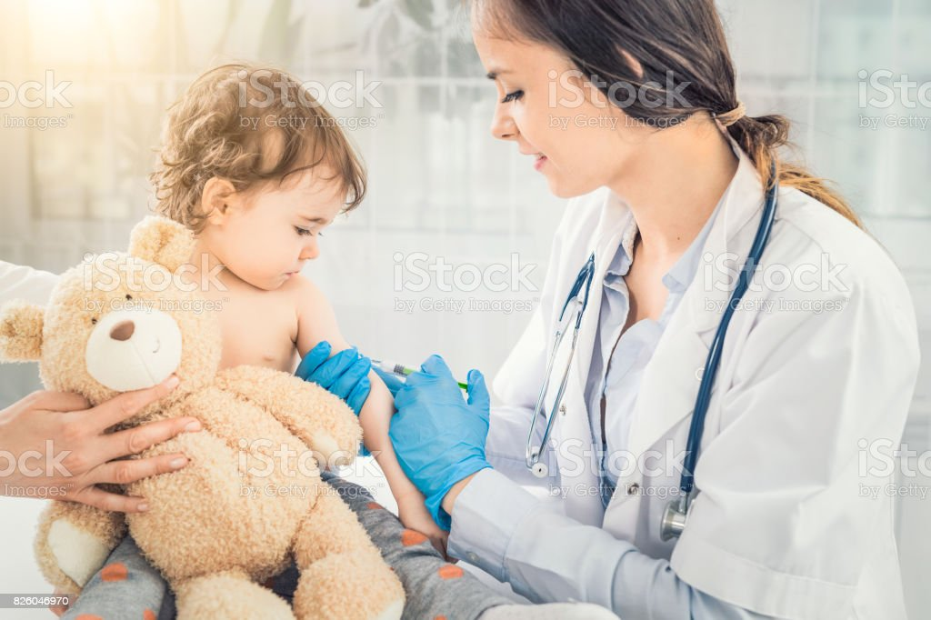 Vaccination little girl. stock photo