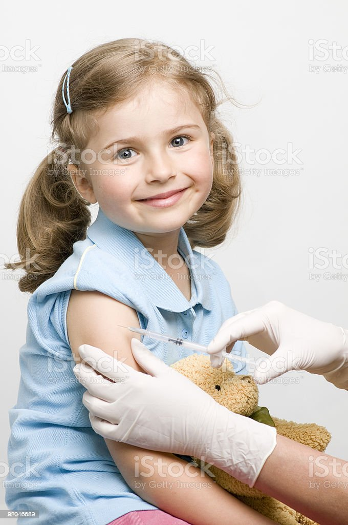 Vaccination of a little girl stock photo