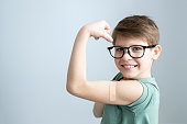 istock Vaccination people. Smiling boy with plaster on his hand after receiving covid-19 vaccine 1311503453