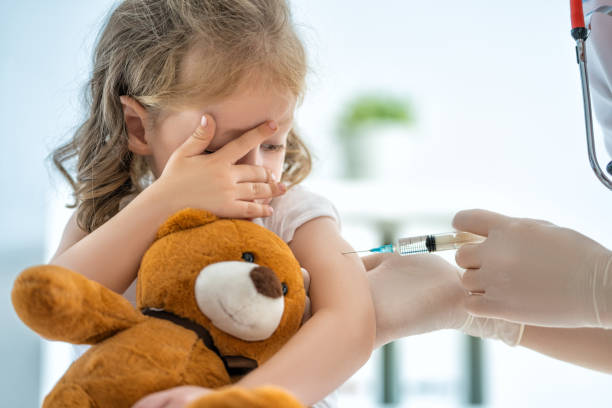 vaccination to a child A doctor making a vaccination to a child vaccine stock pictures, royalty-free photos & images
