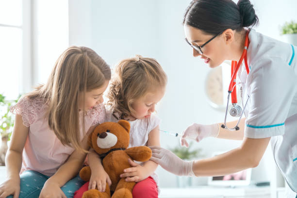 vaccination to a child stock photo