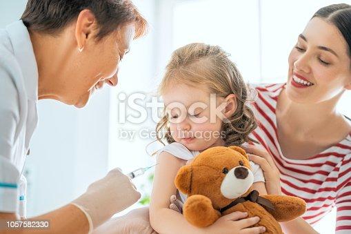 istock vaccination to child 1057582330