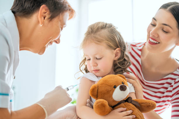 vaccination to child stock photo