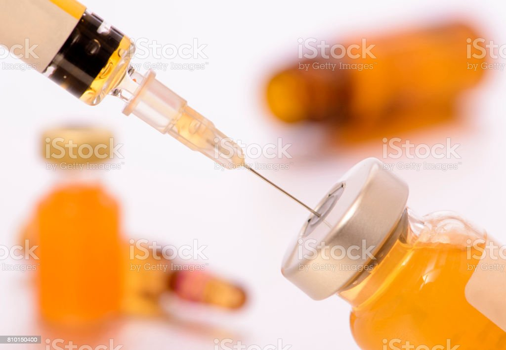vaccination with syringe and serum stock photo