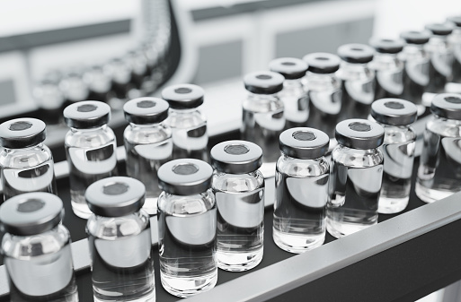 Vaccine vials on a production line in a pharmaceutical factory. Computer generated imagery of medicine for illness prevention.