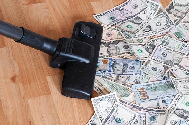 Vacuum cleaner and money stock photo