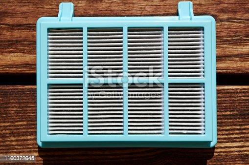 istock vacuum cleaner hepa filter with fiberglass in blue plastic case on the woodeb floor 1160372645