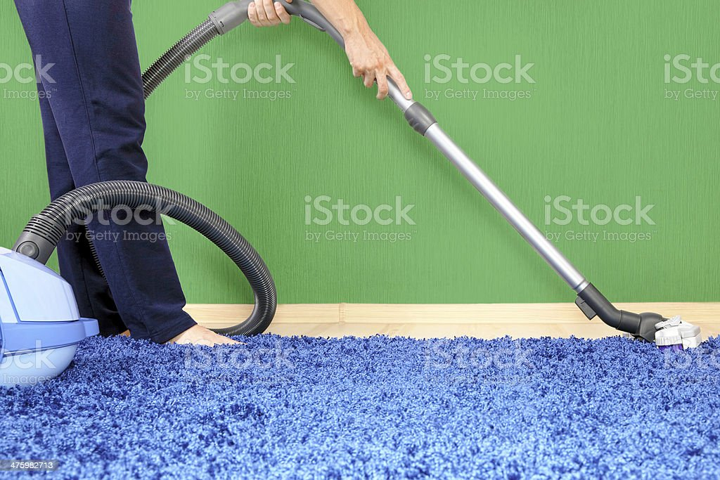 Vacuum cleaner in action stock photo
