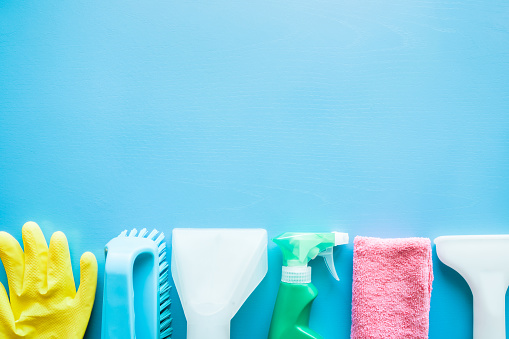 istock Vacuum cleaner nozzle and colorful cleaning set for different furniture surfaces in house. Dry cleaning service concept. Early spring regular clean up. Empty place for text or logo on blue background. 925222958