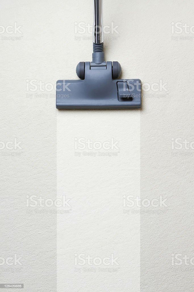 Vacuum cleaner on dirty carpet with copy space stock photo