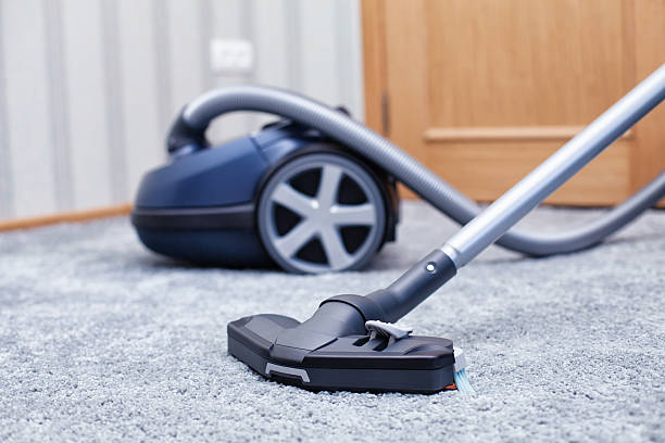 Vacuum cleaner The new vacuum cleaner lies in a room suction tube stock pictures, royalty-free photos & images