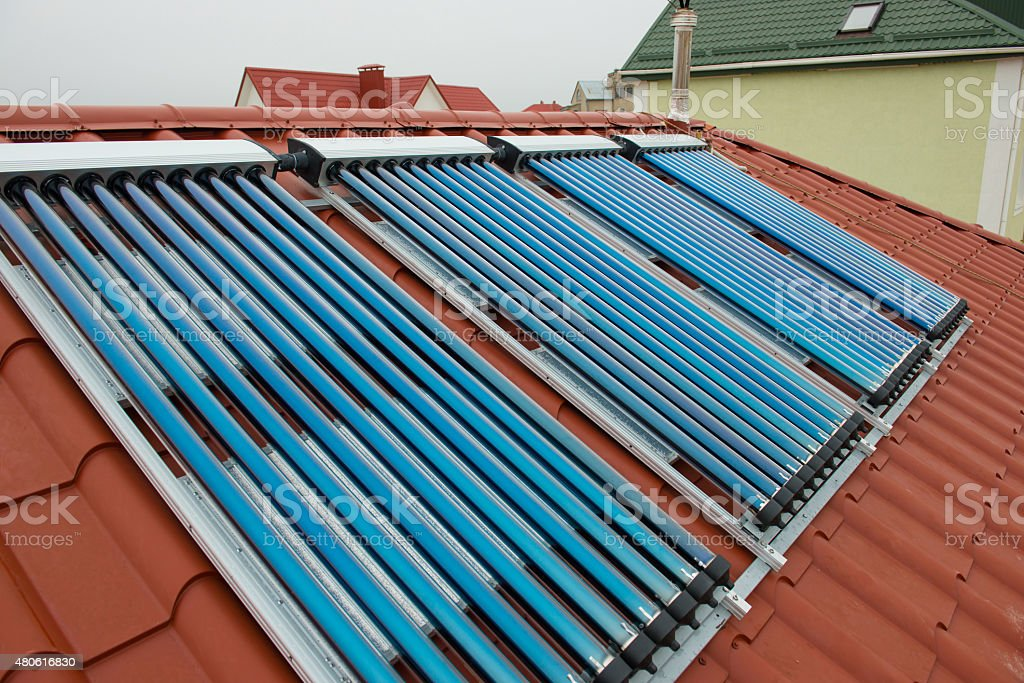 Vacuum collectors- solar water heating system stock photo