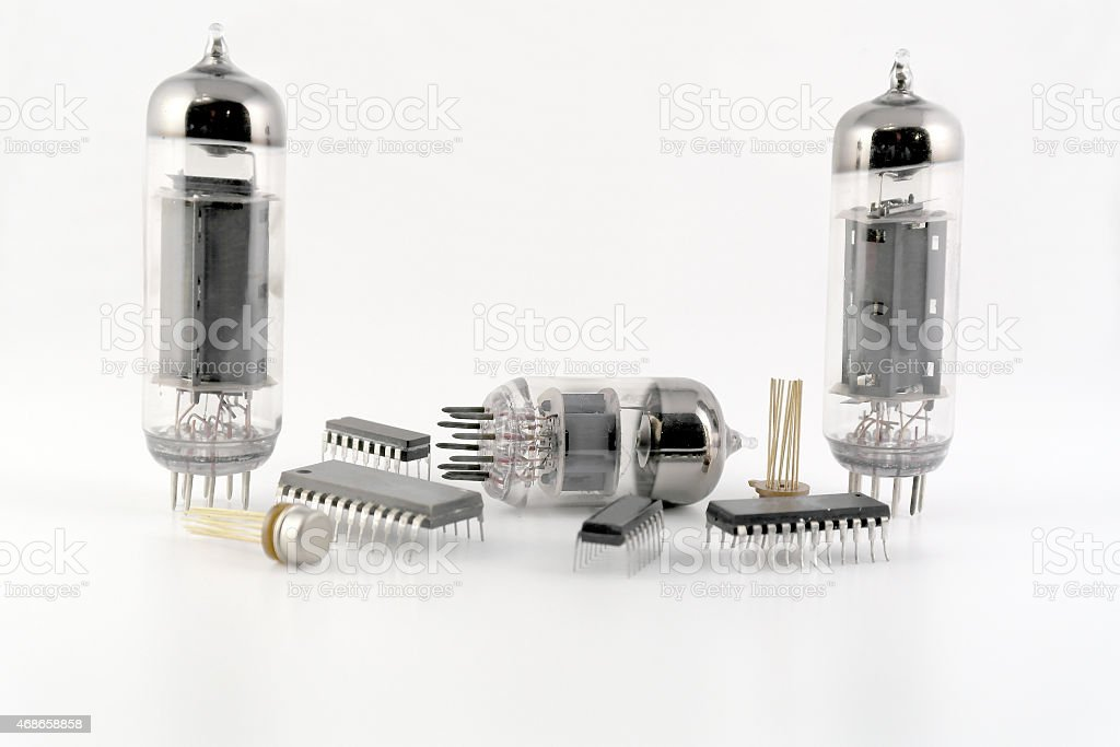 Vacuum radio tubes and semiconductor chips stock photo