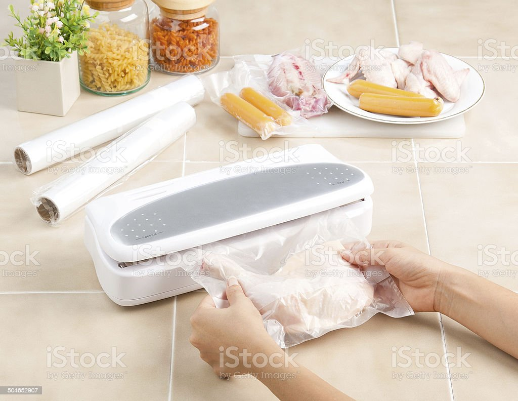 Vacuum seal packing machine stock photo