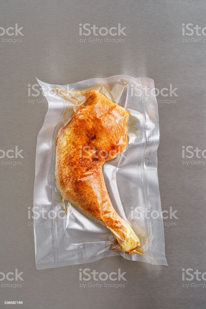 Vacuum sealed chicken thigh stock photo