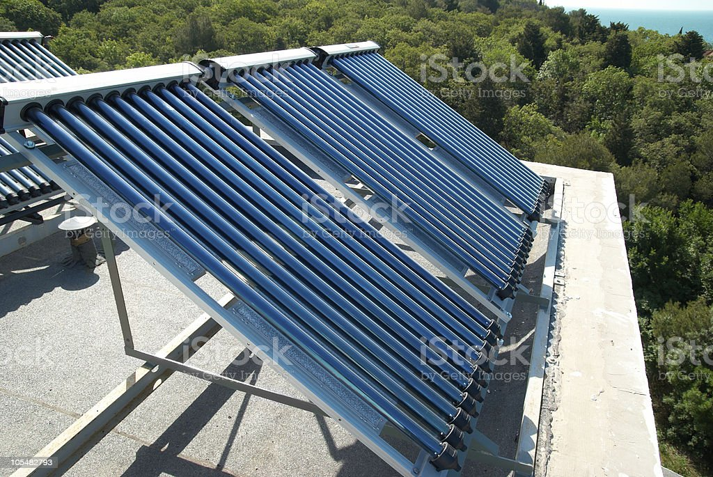 Vacuum solar heating system on the roof of a house stock photo
