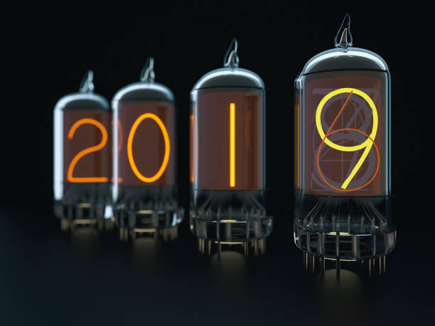 Vacuum tube 2018 Vacuum tube 2018 - 3d rendered image on black background, retro style, New Year change. anode stock pictures, royalty-free photos & images