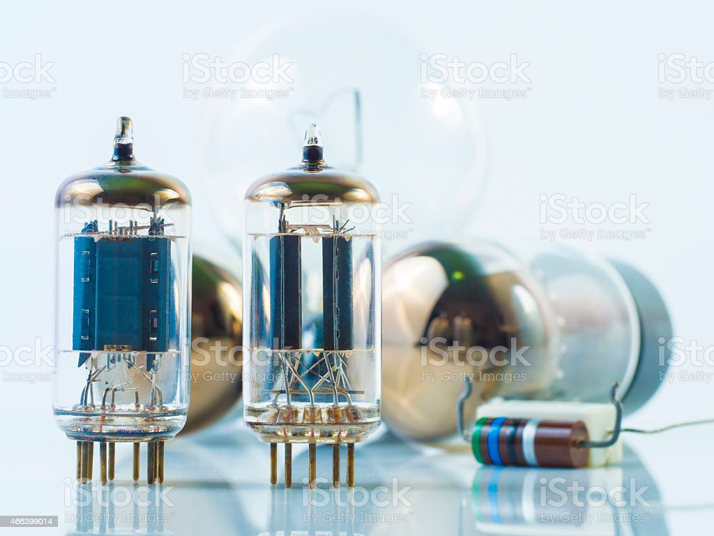 vacuum tube and incandescence bulb on white stock photo