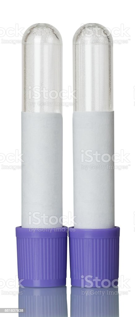 Vacuum tubes for collection of blood isolated on white. stock photo