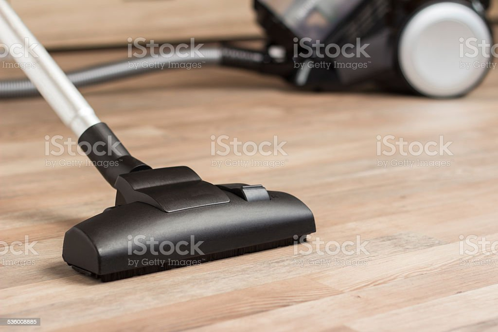 Vacuuming a thick pile white carpet stock photo