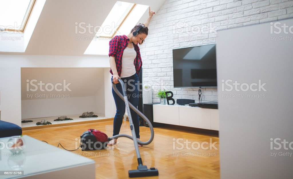 Vacuuming home is fun royalty-free stock photo