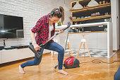 Vacuuming in her way