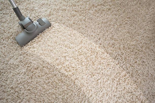 Vacuuming Rough Carpet With Vacuum Cleaner Stock Photo