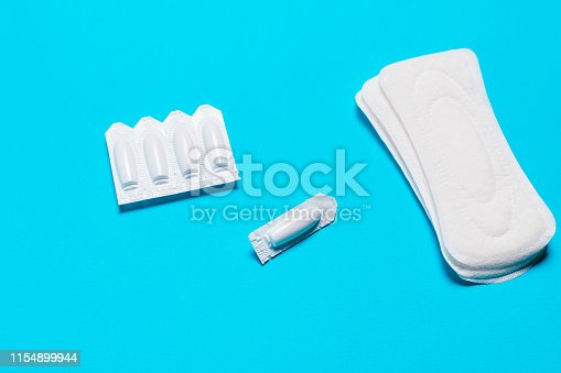 859986274istockphoto vaginal suppositories on a blue background, from candidiasis, thrush, sexually transmitted infections 1154899944