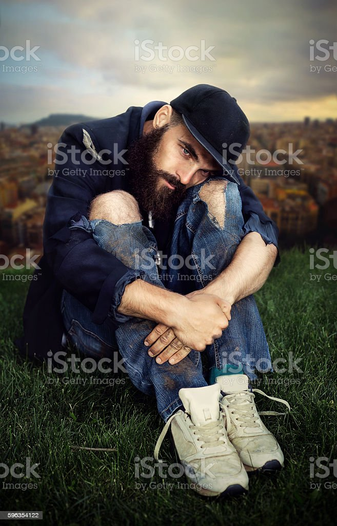 Vagrant in flowerbed royalty-free stock photo