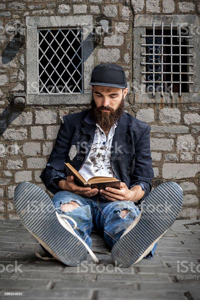 Vagrant reading royalty-free stock photo