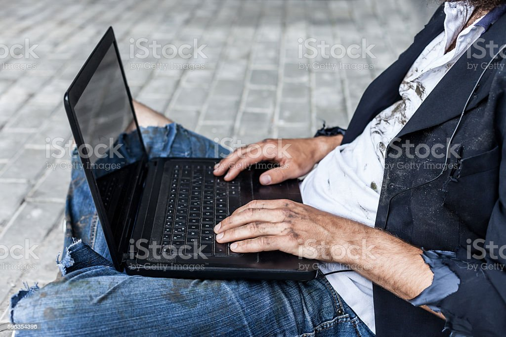 Vagrant with computer royalty-free stock photo