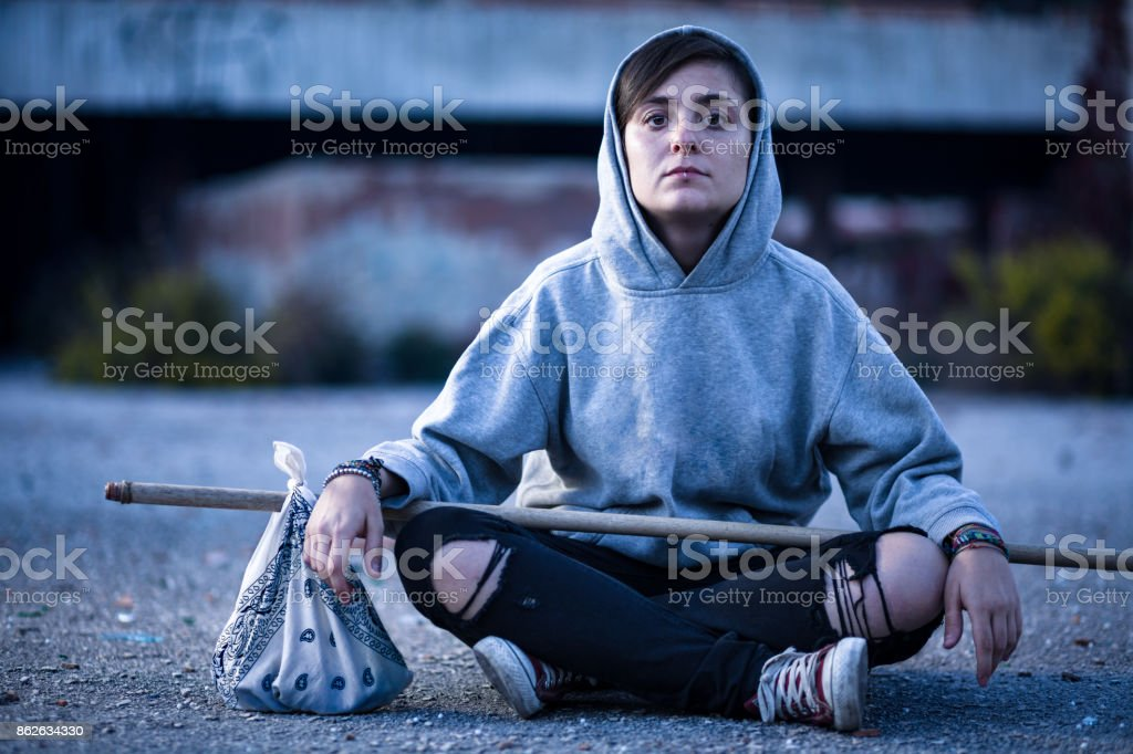 Vagrant Woman with Hobo Stick stock photo