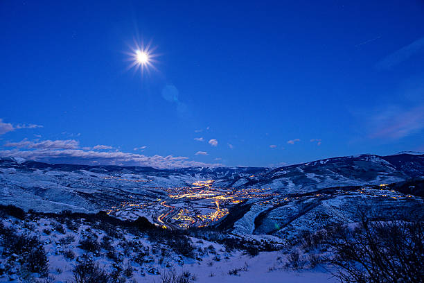 Vail Valley at Night Vail Valley at Night - Vail Colorado view of entire valley at dusk with blue hour light and town lit up with lights and mountain views. vail colorado stock pictures, royalty-free photos & images