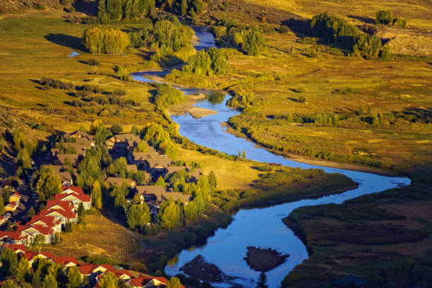 Vail Valley in Autumn Vail Valley in Autumn - View of Eagle River and valley leading from Edwards to Vail, Colorado. avon colorado stock pictures, royalty-free photos & images