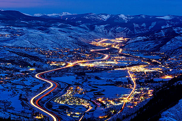 Vail Valley View at Dusk with Beaver Creek Vail Valley View at Dusk with Beaver Creek - Valley and mountain view in winter with Vail, Minturn, Avon, Edwards, Beaver Creek, and Arrowhead.  Vail, Colorado USA. avon colorado stock pictures, royalty-free photos & images