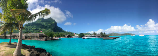 Vaitape village panorama Bora Bora is a major international tourist destination, famous for its aqua-centric luxury resorts. The major settlement, Vaitape, is on the western side of the main island, opposite the main channel into the lagoon. French Polynesia, South Pacific Ocean. south pacific ocean stock pictures, royalty-free photos & images
