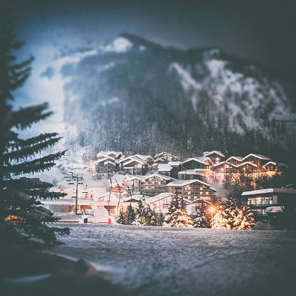 istock Val d'isere french ski resort illuminated village by snowy night in European Alps in winter 913065170