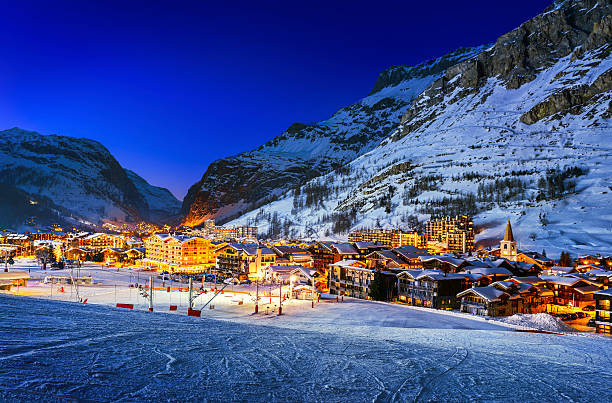 Val d'Isère city Famous and luxury place of Val d'Isere at sunset, Tarentaise, Alps, France apres ski stock pictures, royalty-free photos & images