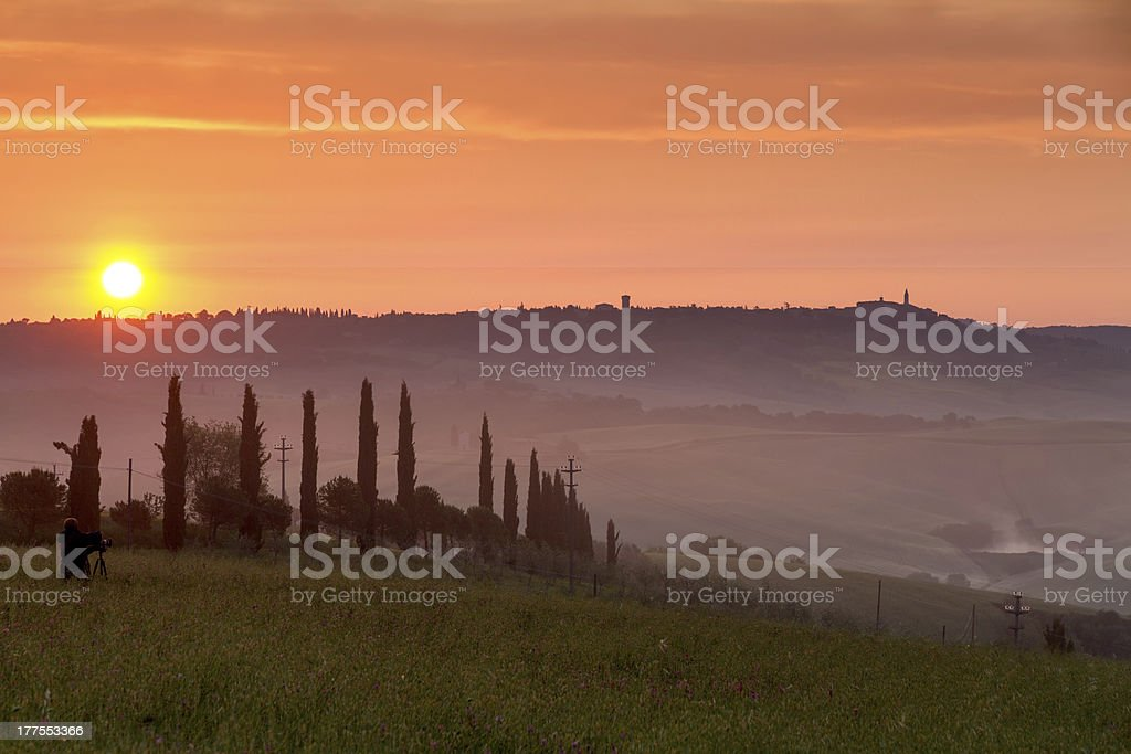Val d'Orcia at sunset with photographer, Tuscany, Italy royalty-free stock photo