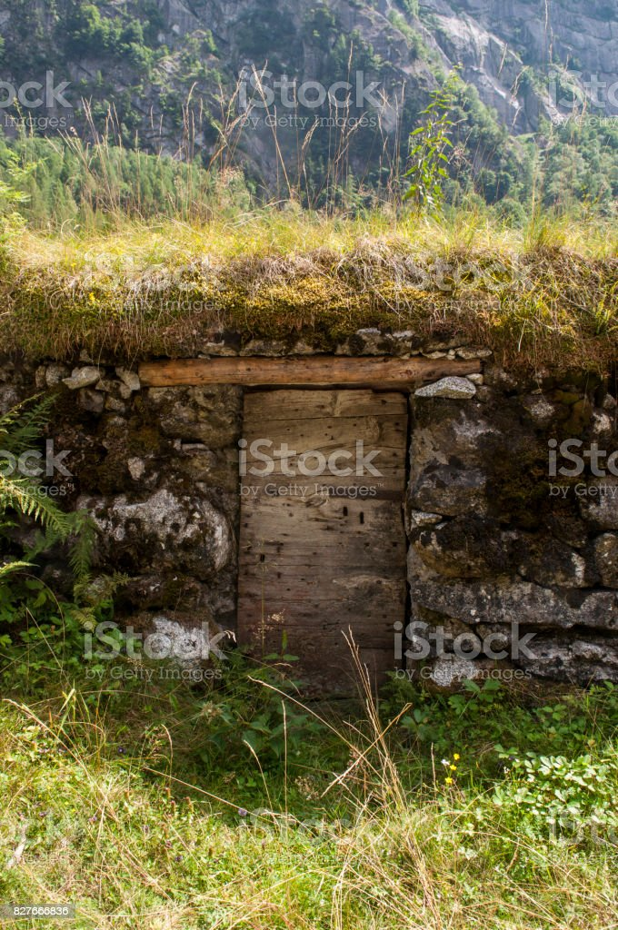Val Masino: an outdoor pantry made in the rock in the Val di Mello, green valley surrounded by granite mountains and forest trees stock photo