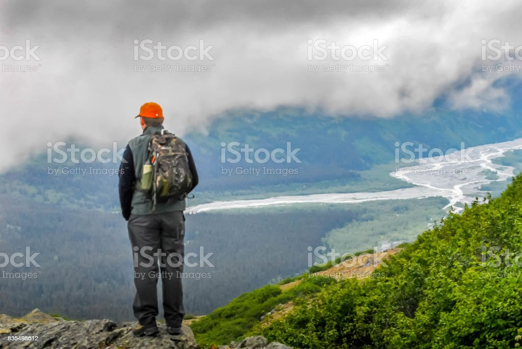 Valdez at Thompson Pass with man overlooking valley stock photo