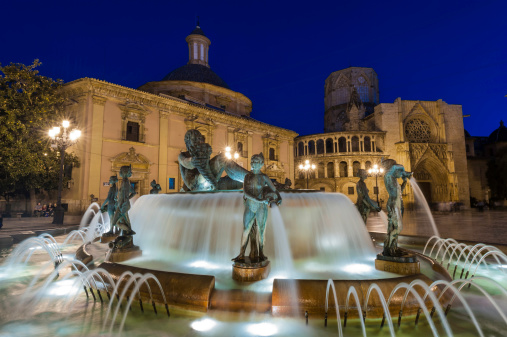 Valencia Plaza de la Virgen fountains and cathedral illuminated Spain