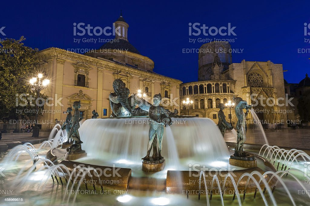 Valencia Plaza de la Virgen fountains and cathedral illuminated Spain stock photo