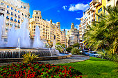 Main city square of Valencia, The Plaza del Ayuntamiento in bright afternoon colors, Spain