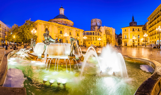 Valencia Turia fountain Plaza de la Virgen illuminated night Spain